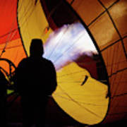 A Man As He Inflates A Hot Air Balloon Poster