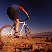 A Mountain Bike Rider On A Ride Poster