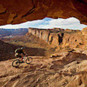 A Mountain Biker Rides By On Slickrock Poster