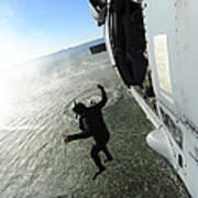 A Naval Air Crewman Jumps From An Poster