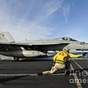 A Shooter Signals To Launch An Fa-18e Poster