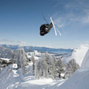 A Skier Doing A Front Flip Into Powder Poster