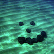 A Smiley Face Formed By Large Boulders Poster