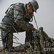 A Soldier Communicates Using A Poster