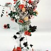 A Studio Shot Of A Vase Of Flowers And A Garden Poster