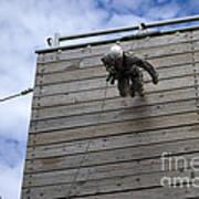 A U.s. Soldier Runs Down A 40-foot Poster