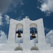 A Whitewashed Bell Tower And Dramatic Poster