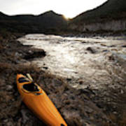 A Whitewater Kayak Rests On The Shore Poster