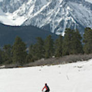 A Woman Bike Riding On The  Snow Poster