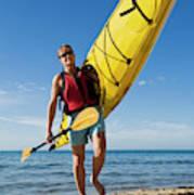 A Woman Carrying Her Sea Kayak Poster