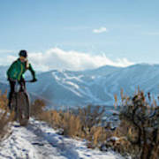 A Woman Fat Biking On The Trails Poster