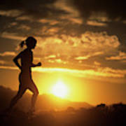 A Woman Jogs Under Sunset Poster