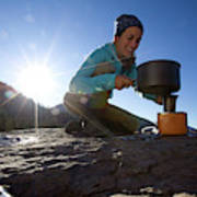 A Woman Making Coffee With Portable Poster