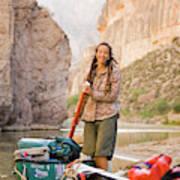 A Woman Unloads Gear From Her Canoe Poster