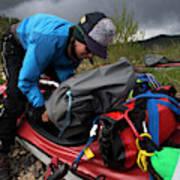 A Woman Unloads Her Kayak Poster