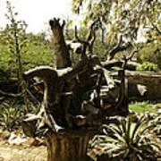 A Wooden Sculpture Inside A Garden Poster