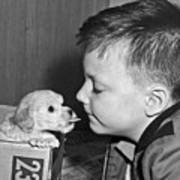 A Young Boy Is Face To Face With A Puppy Tongue. Poster