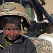 A Young Boy Wears A Coalition Force Poster