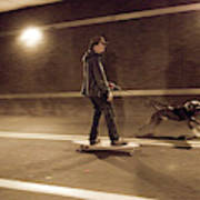 A Young Man On A Skateboard Is Pulled Poster