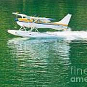 Aircraft Seaplane Taking Off On Calm Water Of Lake Poster