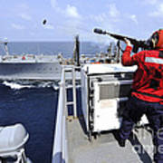 Airman Fires A Shot Line From Uss Poster