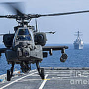 An Army Ah-64d Apache Helicopter Takes Poster