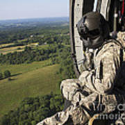An Army Crew Chief Looks Out The Door Poster