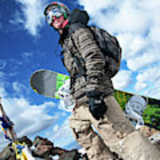 An Extreme Snowboarder Stands Poster