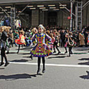 An Irish Dance Group Flying High While Dancing At The 2009 St. Patrick Day Parade Poster