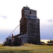 An Old Grain Elevator Off Highway Two In Montana Poster
