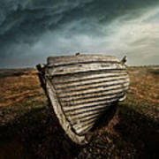 An Old Wreck On The Field. Dramatic Sky In The Background Poster