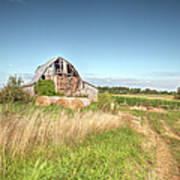 Barn In A Field With Hay Bales Poster