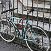 Bicycle Is Chained To A Fence Poster