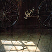Bike Light And Shadow In Barn Poster