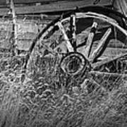 Black And White Photo Of An Old Broken Wheel Of A Farm Wagon Poster