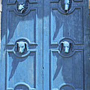 Blue Door Decorated With Wooden Animal Heads Poster