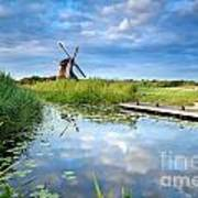 Blue Sky And Windmill Reflected In River Poster