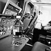 Bottle Of Water On Tray Table Interior Of Jet2 Aircraft Passenger Cabin In Flight Poster by Joe Fox