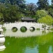 Bridge Over Emerald Water Poster