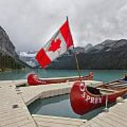 Canoes And Canada Flag At Lake Louise Poster