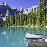 Canoes In Moraine Lake And Valley Of Poster