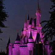 Cinderella Castle Illuminated In Pink Glow Poster