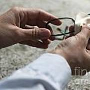 Cleaning Her Eyeglasses Poster