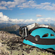 Climbing Helmet With Camera On Mountain Poster