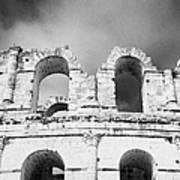 Close Up Of The Top Of The Old Roman Colloseum Against Blue Cloudy Sky El Jem Tunisia Poster