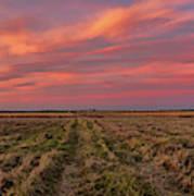 Clouds Over Landscape At Sunset Poster