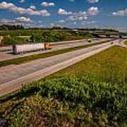 Clover Leaf Exit Ramps On Highway Near City Poster