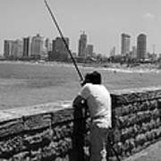 Contemplative Fisherman In Tel Aviv Poster