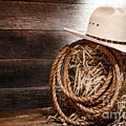 Cowboy Hat On Hay Bale Poster by Olivier Le Queinec