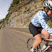 Cyclists Climb A Hill With A Mountain Poster